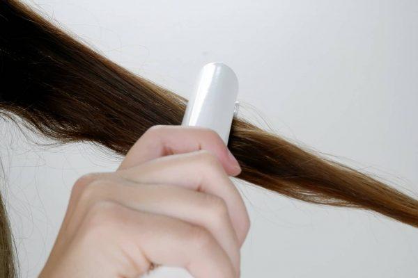 Zkoušení žehlení vlasů